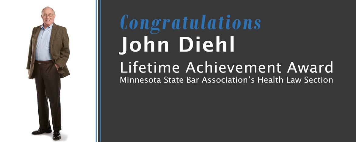 photo of John Diehl standing with announcement of Lifetime Achievement Award